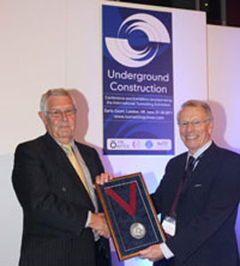 Terry Mellors receives the 2011 medal from Chairman Bob Ibell
