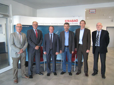 Day of signing: Christoph Kleuters, CEO Aker Wirth, and Wolfgang Lehner, General Manager Strabag AG, (centre left and right) are joined by (left) Jost Wenk, Project Director of Rowa Tunnelling Logistics, Werner Baumann, Managing Director Investmanagement BMTI, and (right) Hans Greve, Vice President Mining & Construction Aker Wirth, and Detlef Jordan, Product Sales Manager TBMs Aker Wirth, to confirm the highly prized TBM order