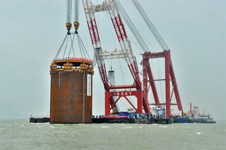 Vibratory driving of the first steel cylinder for the west artificial island