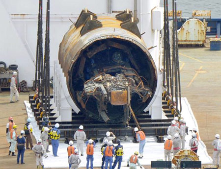 Salvaged TBM on the deck of the recovery barge