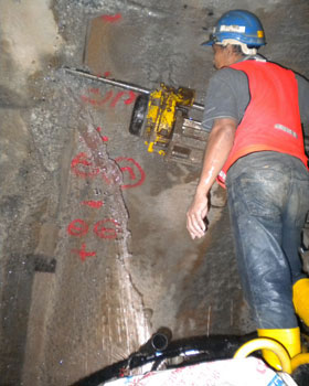 Drilling pre-excavation injection holes into a void fault zone