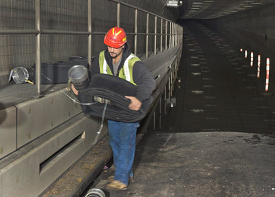 Recovery work in the Hugh L Carey traffic tunnel, which was flooded floor-to-ceiling by Superstorm Sandy
