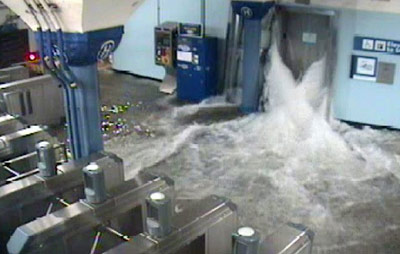 Water floods into Hoboken Station via an elevator shaft