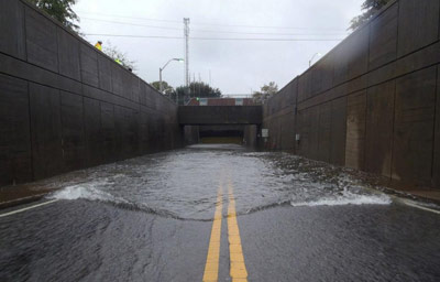 Tide gates on the Norfolk approach of Midtown tunnel successfully held back a 13ft storm surge