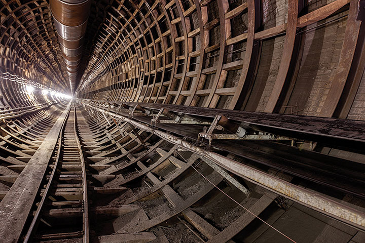 Ring beams and lagging were used for the tunnel lining