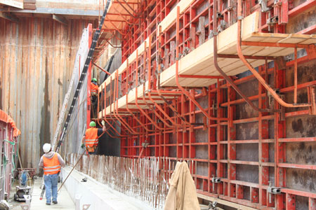 Formwork and reinforcement installation for the cut-and-cover construction within the permanent sheet piles