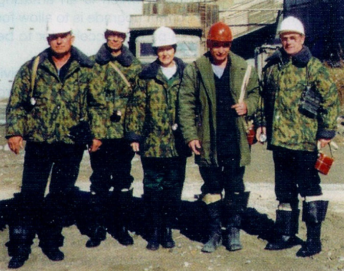 TunnelTalk reporter, Shani Wallis (centre), with site management and engineering staff, from left Gennady Terzimanov, Deputy Chief Engineer; Nick Pedan, Interpreter; Victor Voloshko, Deputy Chief Engineer; and Valerian Kutylovshy, Technical Department Manager, geared up in warm clothing and thigh high waders to make a tour of the underground works from Shaft 4 where ground water ingress continues in high quantities