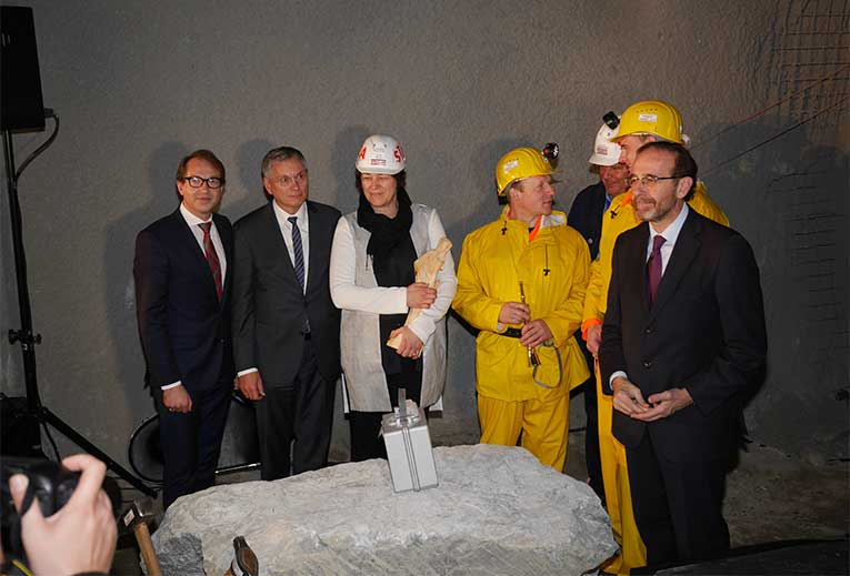 Violeta Bulc, European Commissioner for Transport, holds a statue of Santa Barbara, the patron saint of tunnellers, and after being named the patron of the Ahrental Main Tunnel contract of the Brenner Base Tunnel project in Austria