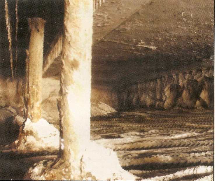 Top section excavation of the sandy core reveals the underneath of the installed roof slab, the outer diaphragm walls and the central column of temporary bored piles supports