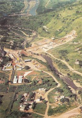 "Central job site in the Emolweni Valley - Clermont Tunnel portal (right), Emolweni Tunnel portal (left) linked by the 250m-long temporary bridge"" style=""width:438px;"