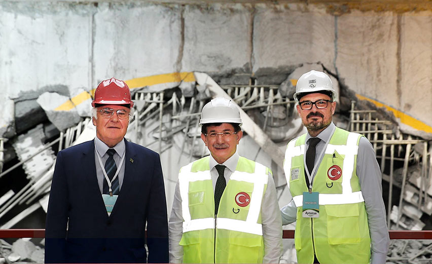 "Turkish Prime Minister Ahmet Davutoğlu (middle), joins Vice Chairman Erdem Arıoğlu of Yapı Merkezi (right) and Martin Herrenknecht (left) at the breakthrough ceremony "" style=""height:236px;"