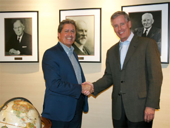 Shaking on the deal: Bob Gomes, President and CEO of Stantec (left); and Alan Krause, Chairman and CEO of MWH Global