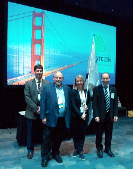 The ITA flag passes from USA to Norway: (from left) Mike Smithson, WTC2016 Chair; Art Silber, UCA of SME President; Heidi Berg, Member of the Norwegian organizing committee of WTC2017; Søren Eskesen, outgoing President of the ITA