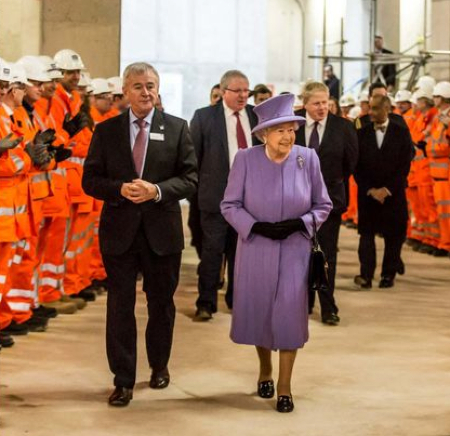 Sir Terry Morgan escorts The Queen on a Royal visit to Crossrail earlier this year