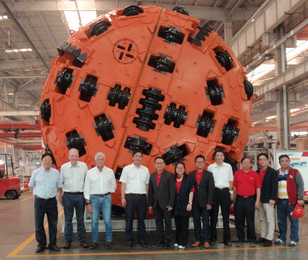Senior managers of Unique Engineering and Construction Ltd and advisers join senior managers of Seli and Sany for factory testing of the double shield TBM