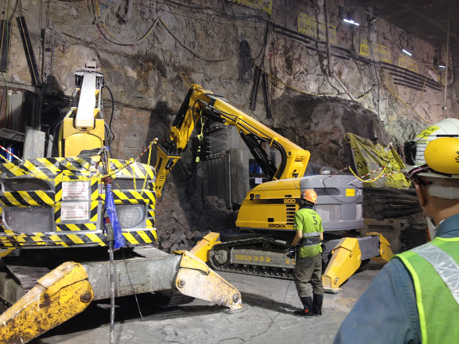 Brokk breaker units working a rock tunnel face