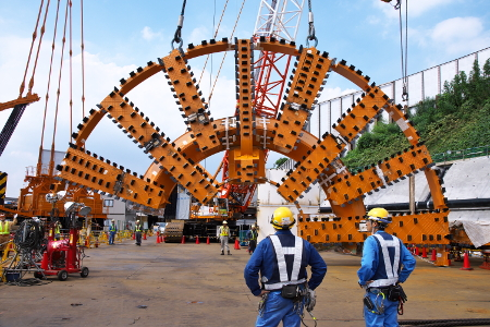 Scale of the 16m-plus diamter cutterhead as it prepares for assembly on the Kawasaki TBM at the Tomei launch site