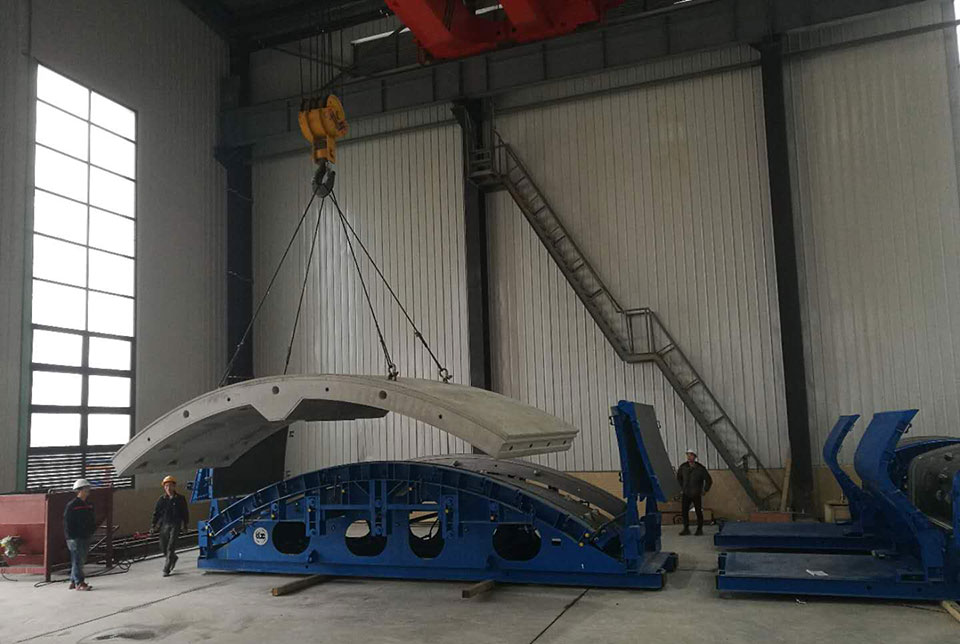Segment section being lifted from the mould