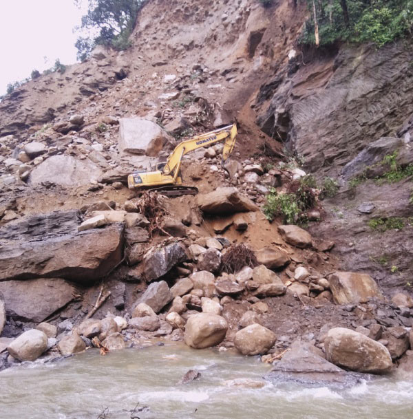 Landslide blocked adit portal and trapped workers