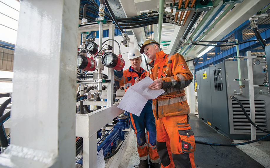 Robbins personnel inspect TBM back-up system