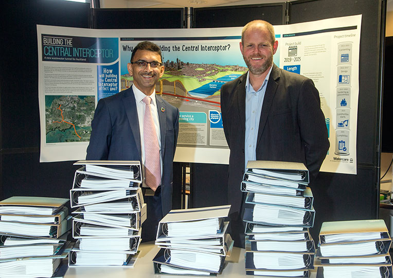 "Watercare Chief Executive Raveen Jaduram (left) and Central Interceptor Executive Programme Director Shayne Cunis with some of the tender documents"" style=""width:380px;"