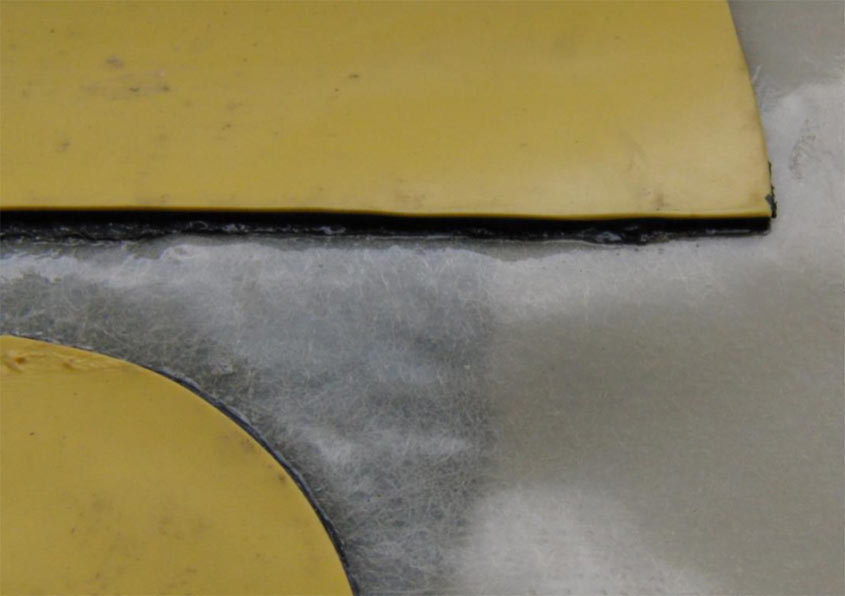 Two types of new membranes (yellow) heat-welded to a Tunnel Reussport sample