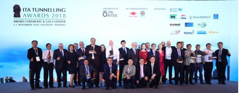 Members of the Awards organising committee, lead by Mrs Jenny Jinxiu Yan (centre in red), and members of the Judging Panel join the celebration of the 2018 Award winners