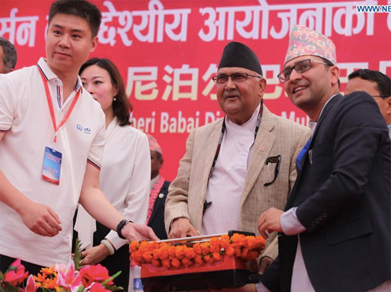 Nepal Prime Minister KP Sharma Oli (centre) officiates at the TBM breakthrough with COVEC Project Manager Tianran Hu (left) and Project Director