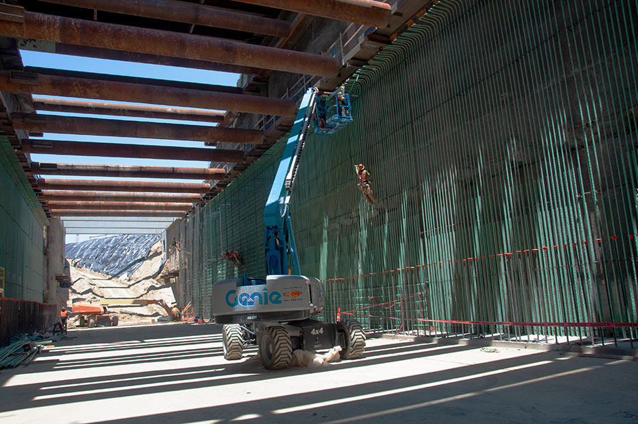Ironworkers tie rebar ahead of casting concrete in the Fresno Trench