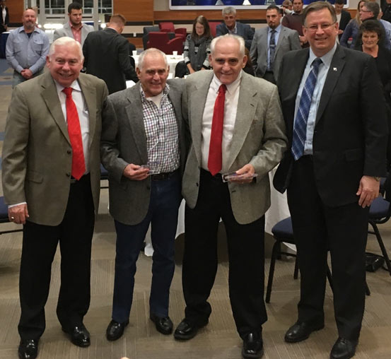 Jim and Leo Barbera, centre left and right respectively, receiving their Lifetime Achievement Awards with Professor Tom Iseley (left) and friends