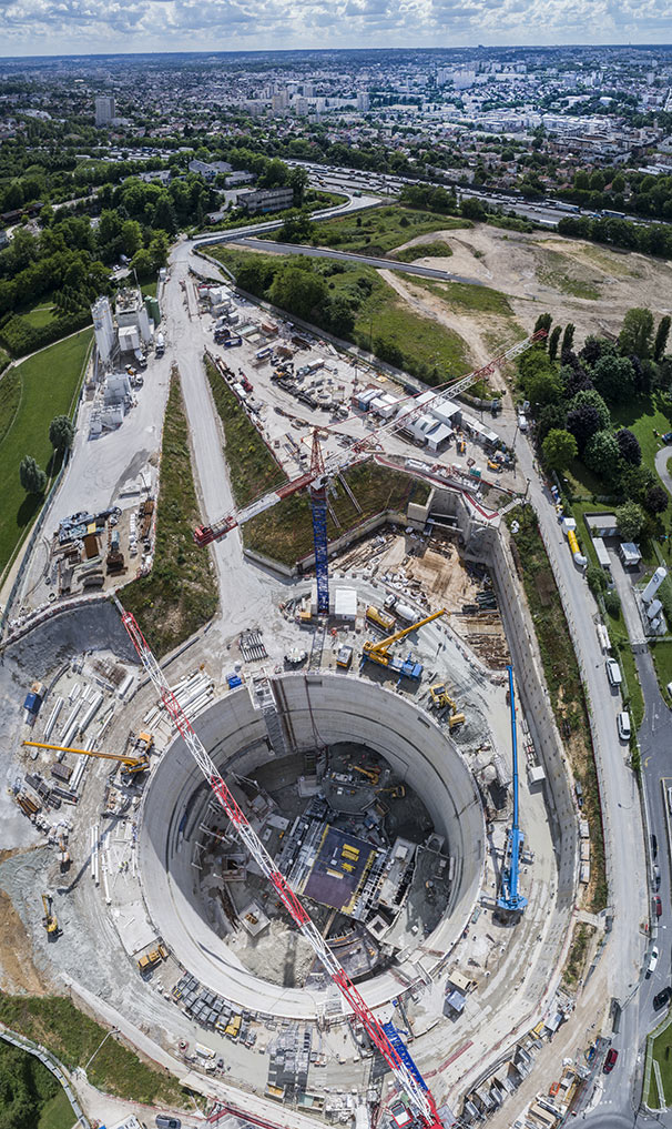 63m diameter x 50m deep shaft is the heart of the Villejuif – Institut Gustave Roussy interchange station
