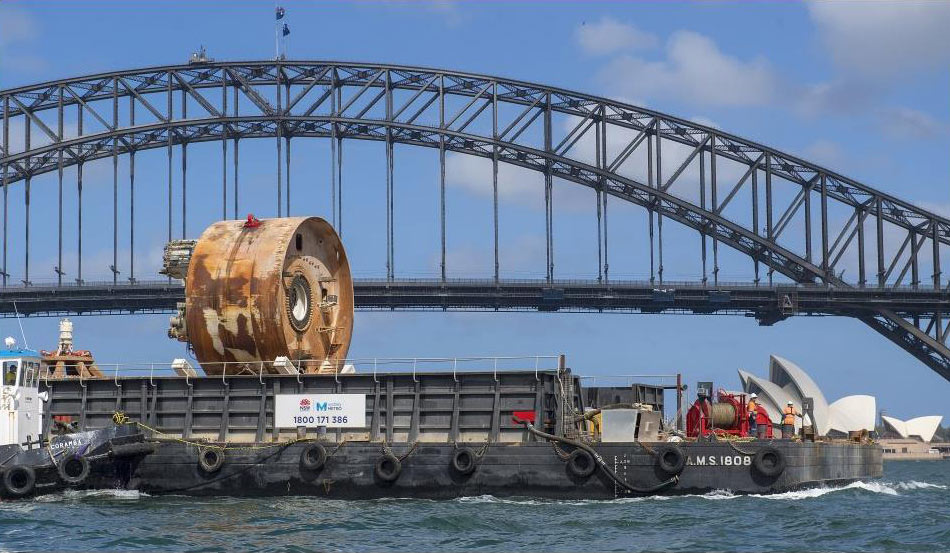 "Mixshield being barged back to Barangaroo for twin under Harbour drive"" style=""width:380px;"