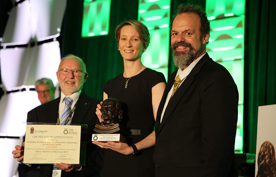 Ed Taylor (left), President of the ATS, and Kate Cole of the Working Group, accept the safety initiative Award from fellow Australian and member of the ITA Executive Council Arnold Dix