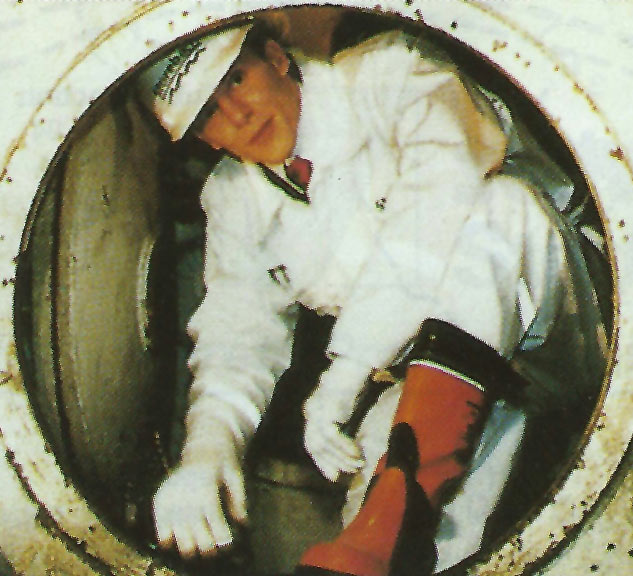 Prince Joachim emerges from the air lock of the  second TBM after being the first person to walk through the completed link in the southern tunnel of the twin tube link
