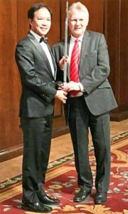 MMC-Gamuda Director of Project and Safety, Datuk Paul Ha Tiing Tai, receiving the BSC Sword of Honour accolade from British Safety Council Chair Lawrence Waterman