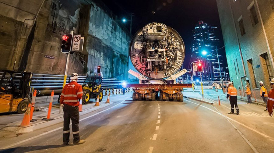 Slurry TBM is transported back to its launch site to prepare for second under-harbour bore