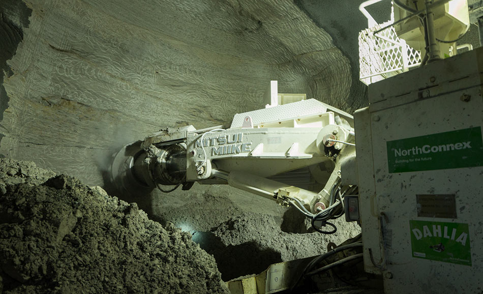 Roadheaders excavated the twin two-lane highway tunnels