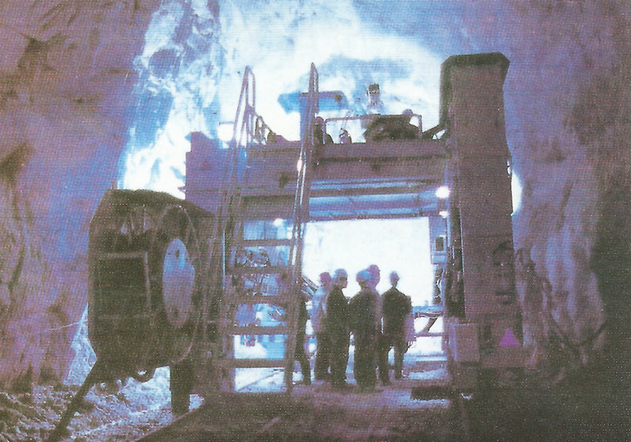 Drill+blast in the 30m<sup>2</sup> pilot tunnel is based on a rail-mounted, gantry type HJ78 Atlas Copco Boomer