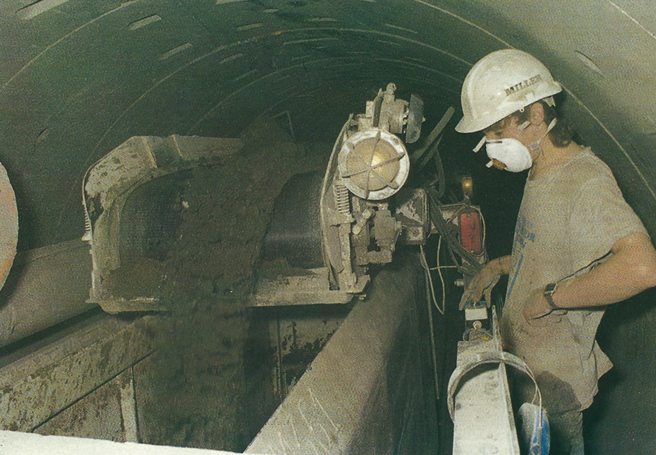Muck wagons empty into the shaft hopper for hoisting to the surface