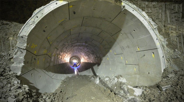 Breakout of a pre TBM drive for station expansion using SCL