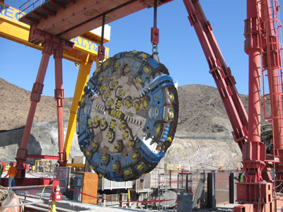 TBM cutterhead being lowered into the launch shaft